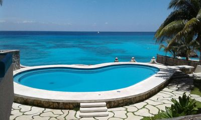 Photo for Oceanfront condo on the bluest ocean of Cozumel island