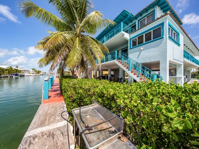 Photo for Breezy half-duplex w/35 ft dock. Includes Cabana Club access w/ pool & beach
