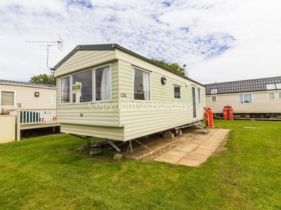Photo for 6 berth caravan for hire by the beach in Heacham in Norfolk. ref 21055C