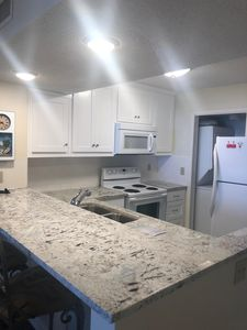 Newly remodeled kitchen with granite countertops and new cabinets!