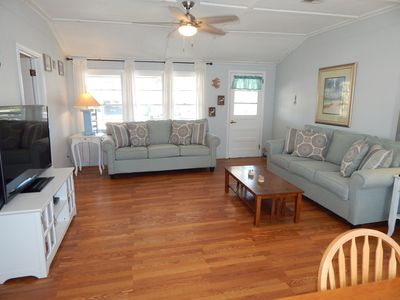Photo for Directly across from the beach! Partial Ocean View. Sleeps 11 in beds! CLEAN