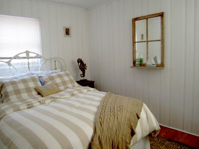 Bedroom with Queen Bed and two windows for cross-ventilation