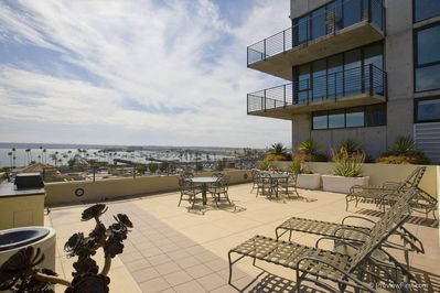 community rooftop deck with grill looking at San Diego Harbor Bay and airport