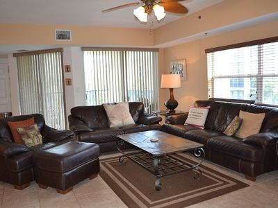 Photo for Beautiful Bohemian themed condo with 3/2 corner unit with pond views. OW15-307