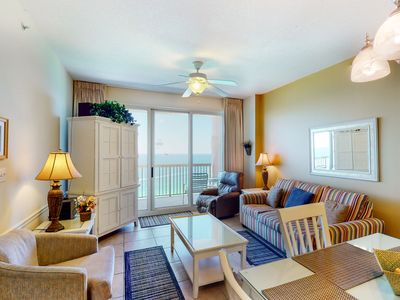 Photo for Beachfront condo w/ amazing views, shared pools, & a gym - steps to the beach!