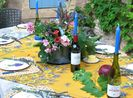 Courtyard granite table set for candlelight dinner, fruit and flowers home grown