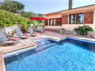 Photo for This 3-bedroom villa for up to 6 guests is located in Caldes De Malavella and has a private swimming