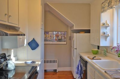 Mill Brook Cottage-The galley kitchen features modern appliances and storage.