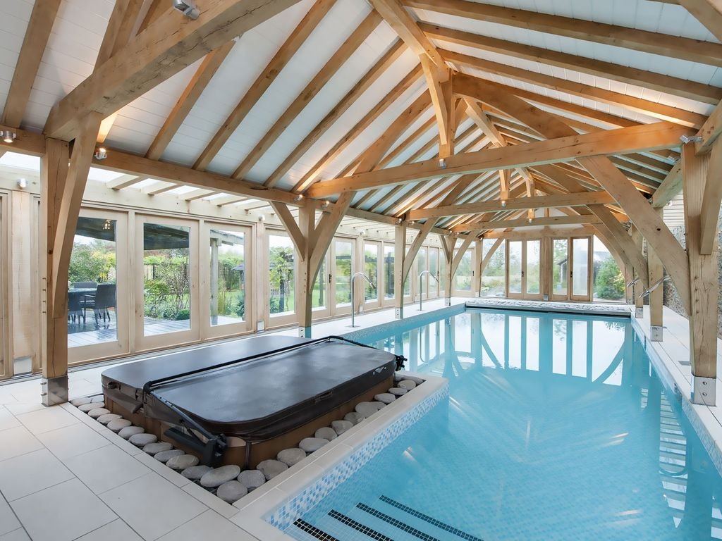 A luxury barn conversion with lavish indoor heated pool for Pool design uk