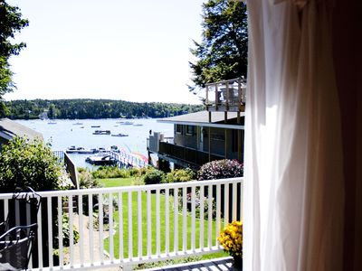 Photo for Walk to Town! Spacious Family Retreat on the Water with Kayaks, Beautiful Dock