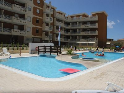 Photo for Holiday apartment with outdoor pool right on the beach