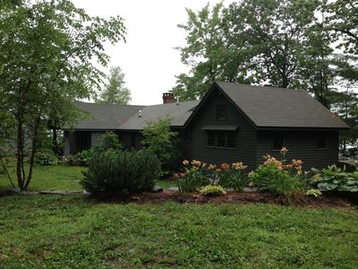 Flower beds in front of cottage