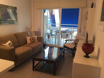 Photo for Apartment in the center of Salou, side sea views, parking and pool