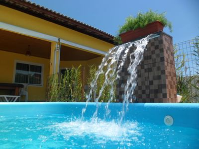 Photo for Fully air conditioned house with 4 suites on the beach near Guarajuba.