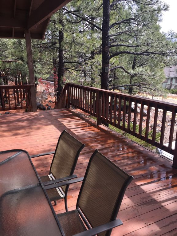 Modern Rustic Cabin w/large front deck w/great views surrounded by pine trees!