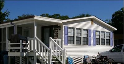 Photo for Walking distance  to Beach,  complimentary golf cart , fall weekly specials