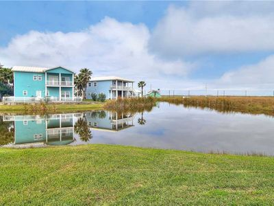 Photo for Overlooking the pond & across from the pool & golf cart accessible boardwalk to the beach