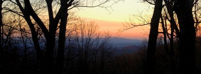The view from the porch with the sun setting over Hendersonville