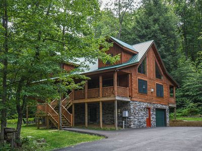 Photo for Charming log home tucked among towering trees with a covered outdoor hot tub!