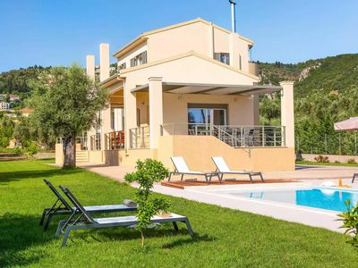 Photo for 5 minutes drive to beach and Lefkas town, countryside setting amongst olive groves, with lovely gardens, stylish and modern decor inside.
