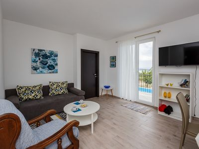 Photo for Beautiful apartment with swimming pool and sea views.