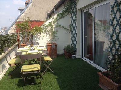 Photo for Charming and bright apartment with 18 m2 terrace overlooking the roofs of Paris