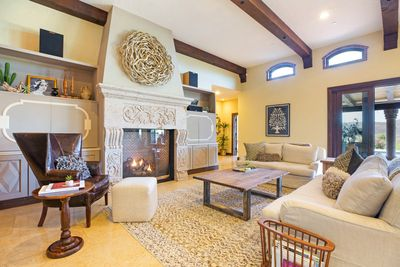Great Room living area with fireplace, television, Sonos