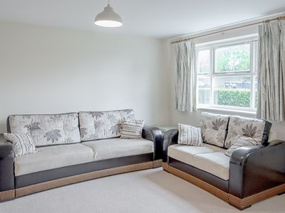 Photo for 2-bed ground floor flat near train station, sleeps 7, free parking