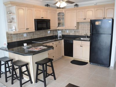 Full kitchen with refrigerator, microwave/stove and all cooking utensils