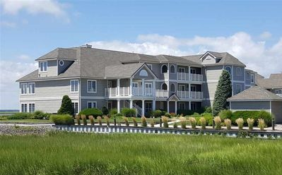 Photo for Wake up to glorious water views and enjoy spectacular golden sunsets from your private deck. MIN 2 WEEKS RENTAL