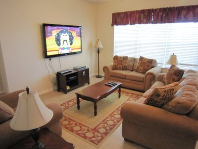 Living Room With Flat Screen TV And Home Entertainment Center For Hours Of Fun