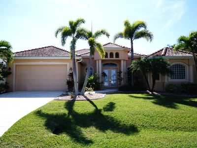 Photo for Villa Blue Water - Cape Coral 4b/3ba  luxury home w/electric heated pool/spa, gulf access canal, HSW