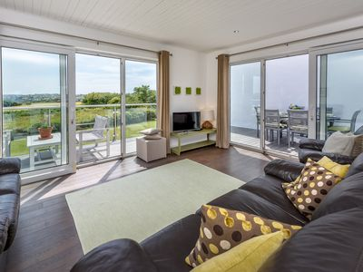 Photo for Enjoying far-reaching views towards the sea from the spectacular balcony, this attractive house is p