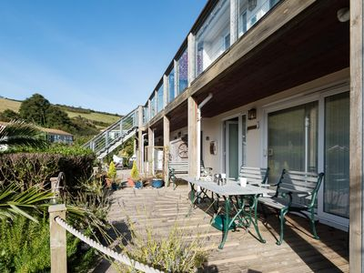 Photo for Lovely apartment with outside decking area, sea views and parking.