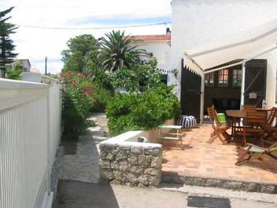 Photo for 30 metres from the beach, pleasant houses with wooded garden