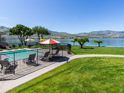 Photo for Lovely lakefront condo with a shared pool, hot tub, dock, and tennis courts!