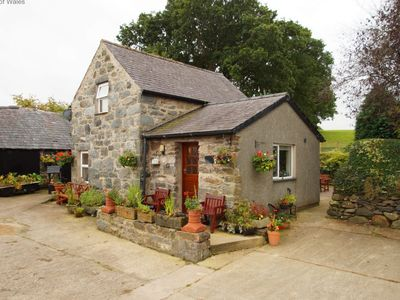 Photo for This comfortable stone cottage is ideally located for easy access to the wealth of attractions North