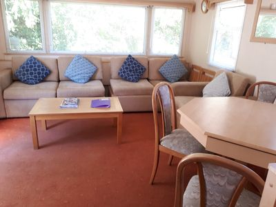 The living room of our holiday caravan has a dining table with chairs