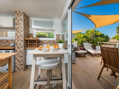Photo for Centrally located with large terrace overlooking the sea - Beach Inn