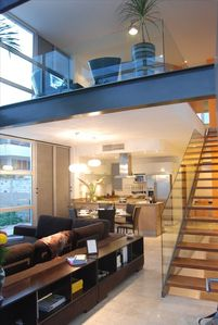 Two level private condo with double height ceiling in social area.