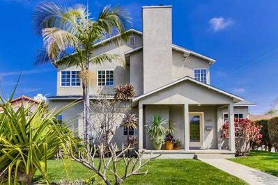 Beautiful extra large home with large backyard, guest house and garage.