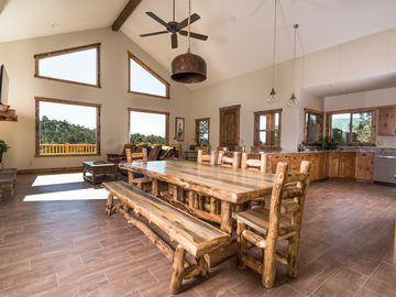 Newer home on a with canyon view, Hot tub, volleyball court in front yard.