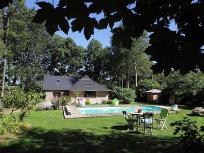 Photo for Between land and sea home bihan coat (small wooden Breton) private heated pool 20 minutes from beaches