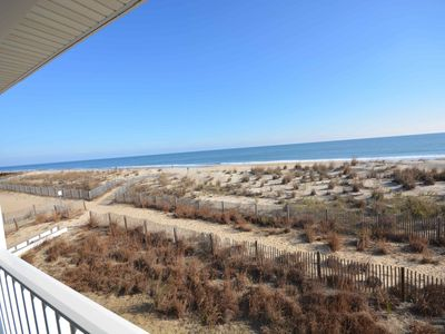 Photo for Traditional, spacious 2-bedroom oceanfront condo with free WiFi and a covered balcony located uptown and mere steps from the beach!