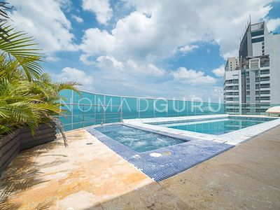 Photo for LUXE Duplex PH w/ PVT Pool & Jacuzzi by NOMAD GURU
