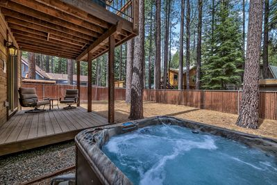 Sit back and soak in the surrounding nature from the backyard hot tub