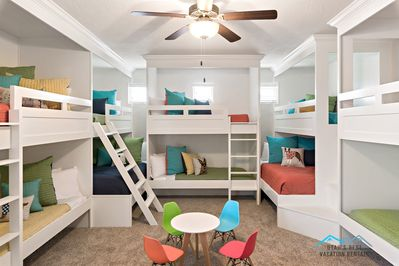 - Large kids bunk bedroom, 3 twin over twin bunks and 2 twin over queen bunks