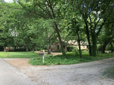 Property surrounded by a field and quiet neighbors with horses on an end street.