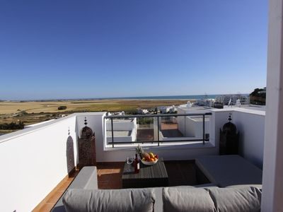 Photo for Casa Amistad - Modern terraced house with sea views and communal pool