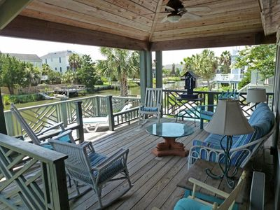 Photo for Cozy beach cottage, dock, salt marsh creek view, walk to beach, dog friendly
